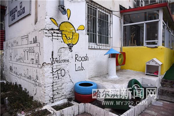 老楼墙壁上绘涂鸦-哈尔滨新闻网-东北网